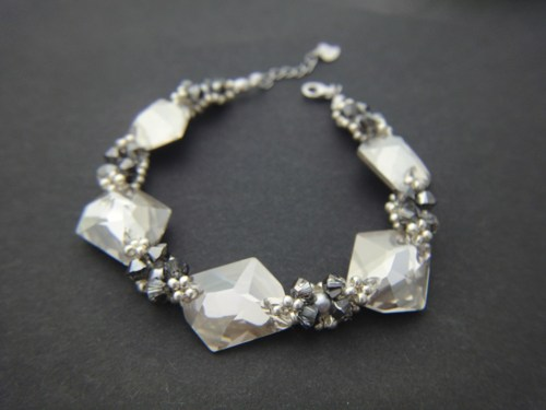 crystal silver night and crystal silver sahde swarovski cosmic crystals sterling silver bracelet