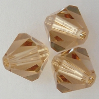 Swarovski Crystal 5328 Xilion Bicone Beads Light Colorado Topaz