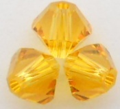 Swarovski Crystal 5328 Xilion Bicone Beads Sunflower color